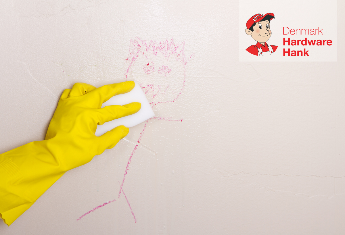 Denmark Hardware Hank cleaning crayon off wall with magic eraser